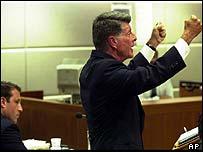 Jeremy Morse (L) listens while his lawyer, John Barnett, addresses the jury