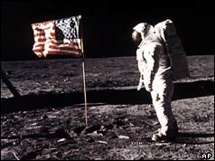 Astronaut and US flag on the Moon