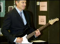 Tony Blair playing the guitar