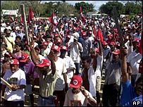 Members of the Landless Rural Workers Movement shout during a rally at a camp in Eunapolis, April 2000