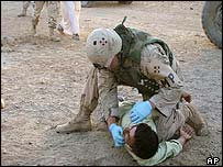US soldier detains Iraqi man during