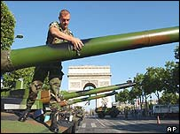 Soldier polishes cannon of tank