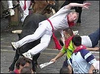 Bull-runner tossed into air