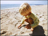 Child playing on a beach