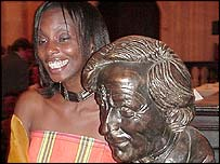 Yvonne Adhiambo Owuor standing by the statue of the late Sir Michael Cane in Oxford