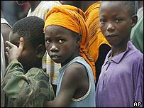 Children in Liberia queue to receive food and blankets in Liberia