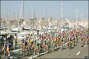 The peloton ride past Marseille's old harbour