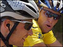 Ivan Basso (left) talks to Armstrong