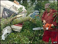Caravan crushed by tree at Gennes