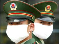 Military policemen wear masks to protect against the Sars in Beijing in May