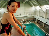 Chinese diver Fu Mingxia takes a break during a training session in Beijing, 1999