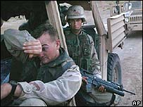 US Army Third Infantry Division soldier wipes his brow as his convoy travels through Iraq