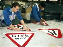 Workers making signs