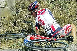 Belgium's Rik Verbrugghe falls off his bike
