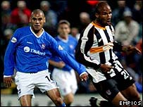 George Santos (right) swaps Grimsby's colours for those of Ipswich