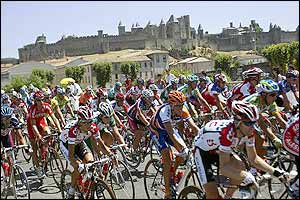 The peloton rides past Carcassonne