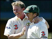 Australia's Brett Lee is congratulated by captain Steve Waugh