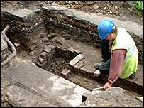 Archaeologist examines foundations at Greyfriars Tower