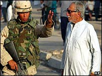 US soldier talks to Iraqi civilian