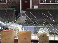 Front window of home was shattered by bomb