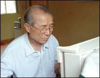 Park Jong Lin at his computer