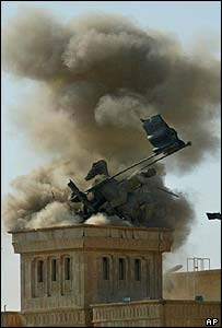 US forces blow up a bronze statue of Saddam Hussein posing on horseback near the gate to his former palace compound in Tikrit, his home town, 18 July 2003