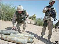 US troops examine empty shells during a raid in Tikrit