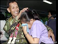 Thai soldier says goodbye to his daughter before leaving for Iraq