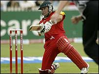Brad Hodge hits a boundary