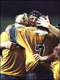 Australia's John Eales celebrates the 1999 World Cup final win with his team-mates