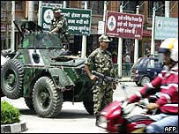Soldiers stand guard at a Kathmandu junction