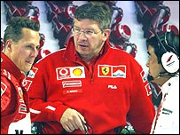 Michael Schumacher talks to Ferrari technical director Ross Brawn and head of Bridgestone tyre development Hirohide Hamashima