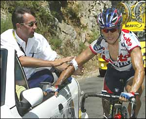A member of the Tour medical team treats Robbie McEwen's elbow