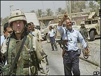 US soldier and Iraqi policeman in Baghdad