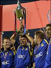 Adam Hollioake recives the trophy