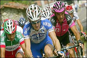 Italy's Paolo Bettini, Michael Rogers and Daniele Nardello in action on the first climb of the stage