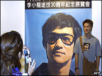 Lee fan with poster