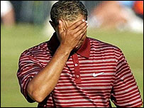 Tiger Woods holds his head in dejection during his final round
