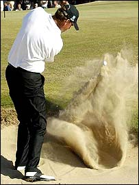 Thomas Bjorn fails to get out of the bunker on the 16th