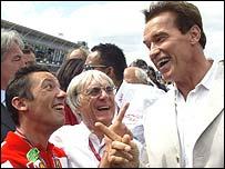 Bernie Ecclestone flanked by Frankie Dettori and Arnold Schwarzenegger