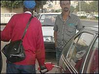 Petrol pump attendant filling tank