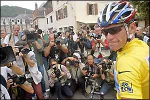 Lance Armstrong poses for photographers before stage 15