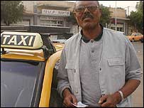 Asmara taxi driver with a petrol coupon