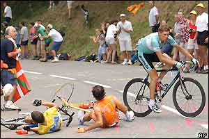 Lance Armstrong and Iban Mayo lie on the road while Jan Ullrich veers away from trouble