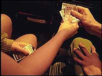 sex worker receiving payment for services