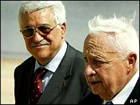 Palestinian Prime Minister Mahmoud Abbas [left] with Israeli Prime Minister Ariel Sharon during earlier talks