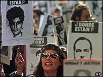 Protesters in Chile hold up pictures of those missing