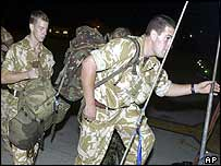British soldiers board a transport plane to take them from Cyprus to Basra, Iraq