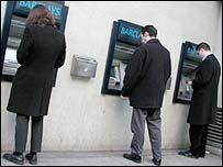 People using cash machines