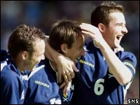 Paul Dickov, Neil McCann and Barry Ferguson celebrate